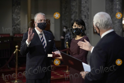 Alaska  Photo - United States Senator Dan Sullivan (Republican of Alaska) raises his hand to take the oath of office from US Vice President Mike Pence as his wife Julie Fate holds a Bible during a reenactment ceremony in the Old Senate Chamber at the Capitol in Washington Sunday Jan 3 2021 (AP PhotoJ Scott Applewhite Pool)Credit J Scott Applewhite  Pool via CNPAdMedia