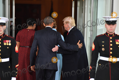 President Barack Obama Photo - President Barack Obama (C) escorts President-elect Donald Trump and wife Melania into the White House for tea before the inauguration on January 20 2017 in Washington DC  Trump becomes the 45th President of the United States Photo Credit Kevin DietschCNPAdMedia