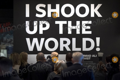 Alias Photo - United States President Donald Trump (C) walks under a quote by Muhammad Alias he tours the Smithsonian National Museum of African American History  Culture in Washington DC on February 21 2017 Photo Credit Kevin DietschCNPAdMedia