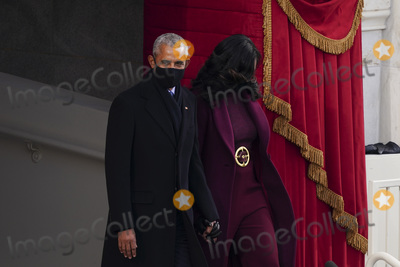 First Lady Michelle Obama Photo - Former US President Barack Obama left and former First Lady Michelle Obama wear protective masks while arriving during the 59th presidential inauguration in Washington DC US on Wednesday Jan 20 2021 Biden will propose a broad immigration overhaul on his first day as president including a shortened pathway to US citizenship for undocumented migrants - a complete reversal from Donald Trumps immigration restrictions and crackdowns but one that faces major roadblocks in Congress Photographer Kevin DietschUPIBloombergAdMedia