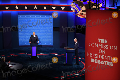 CHRIS WALLACE Photo - President Donald Trump and Democratic presidential nominee Joe Biden with moderator Chris Wallace prepare to face off in the first of three scheduled 90 minute presidential debates in Cleveland Ohio on Tuesday September 29 2020 Credit Kevin Dietsch  Pool via CNPAdMedia