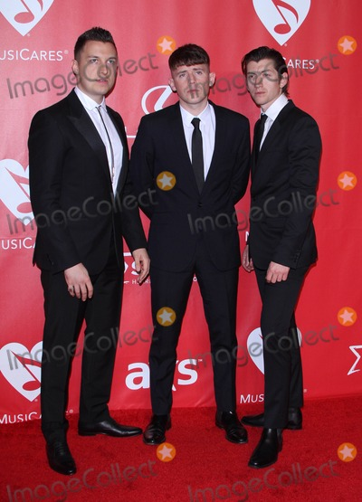 Alex Turner Photo - 6 February 2015 - Los Angeles California - Matt Helders Jamie Cook and Alex Turner of Arctic Monkeys 2015 MusiCares Person Of The Year Gala Honoring Bob Dylan held at the Los Angeles Convention Center Photo Credit AdMedia