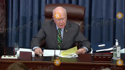 The Used Photo - In this image from United States Senate television United States Senator Patrick Leahy (Democrat of Vermont) President pro tempore of the US Senate reads the verdict of the Senate on the single Article of Impeachment against former US President Donald J Trump during Day 5 of the second impeachment trial of the former president in the US Senate in the US Capitol in Washington DC on Saturday February 13 2021Mandatory Credit US Senate TV via CNPAdMedia