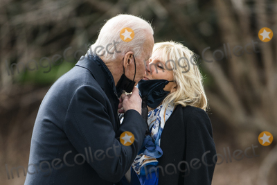 Kiss Photo - First Lady Jill Biden (R) kisses US President Joe Biden (L) goodbye as he departs the White House for a short visit with wounded veterans at Walter Reed Medical Center in Washington DC USA 29 January 2021Credit Jim LoScalzo  Pool via CNPAdMedia