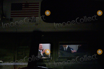 THE WINDOW Photo - Acting White House Chief of Staff Mick Mulvaney is seen through the window of Marine One prior to its departure from the South Lawn of the White House in Washington DC as he accompanies United States President Donald J Trump to the World Economic Forum in Davos Switzerland on January 20 2020Credit Erin Scott  Pool via CNPAdMedia
