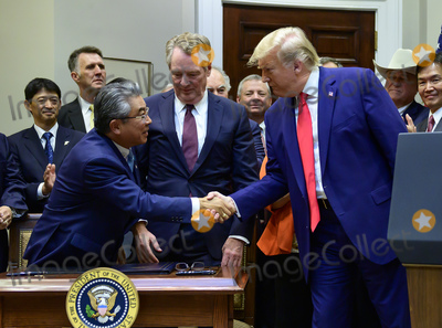 The Used Photo - United States President Donald J Trump right shakes hands with Ambassador Shinsuke Sugiyama Ambassador of Japan to the US left after he signed the US-Japan Trade Agreement and US-Japan Digital Trade Agreement in the Roosevelt Room of the White House in Washington DC on Monday October 7 2019 Photo Credit Ron SachsCNPAdMedia