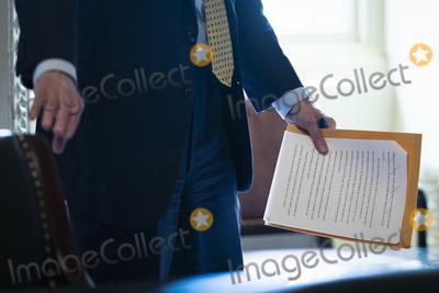 Bill Cassidy Photo - WASHINGTON DC - FEBRUARY 12 Sen Bill Cassidy R-La talks with staff in the Senate Reception room on the fourth day of the Senate Impeachment trials for former President Donald Trump on Capitol Hill on Friday Feb 12 2021 in Washington DCCredit Jabin Botsford  Pool via CNPAdMedia