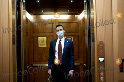 Josh Hawley Photo - Senator Josh Hawley a Republican from Missouri wears a protective mask while arriving to the US Capitol in Washington DC US on Saturday Feb 13 2021 The Senate approved 55-45 a request to consider calling witnesses in the second impeachment trial of Donald Trump a move that may extend the trial that was expected to end within hours Credit Stefani Reynolds - Pool via CNPAdMedia