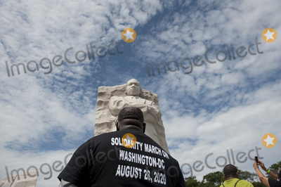 Martin Luther King Jr Photo - A man stands under the sculpture of Martin Luther King Jr at the Martin Luther King Jr Memorial following the Get Your Knee Off Our Necks March on Washington at the Lincoln Memorial in Washington DC Friday August 28 2020 Credit Rod Lamkey  CNPAdMedia