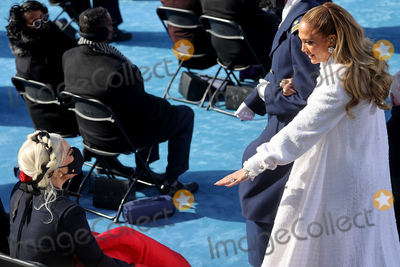 JENNIFER LOPEZ Photo - Jennifer Lopez greets Lady Gaga after performing during the inauguration of Joe Biden as the 46th President of the United States on the West Front of the US Capitol in Washington US January 20 2021  REUTERSJonathan ErnstPoolAdMedia