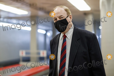 Alabama Photo - Senator Richard Shelby a Republican from Alabama wears a protective mask while walking through the Senate Subway at the US Capitol in Washington DC US on Thursday Feb 11 2021 House prosecutors used the second day of Donald Trumps impeachment trial to detail a months-long campaign by the former president to stoke hatred and encourage violence over the election results that they said culminated in the mob attack on the US Capitol that he then did little to stop Credit Ting Shen - Pool via CNPAdMedia