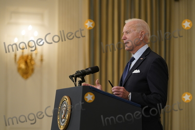 The Vaccines Photo - United States President Joe Biden delivers remarks on the Covid-19 response and the vaccination program from the State Dining Room of the White House in Washington DC on Tuesday May 4 2021  The President announced he will allow some governors to turn down doses they dont need or want and reallocate those doses to other states and he also set a goal of getting at least one dose of the Covid-19 vaccine to 70 percent of adults by July 4Credit Alex Edelman  Pool via CNPAdMedia