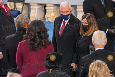 Mike Pence Photo - Outgoing US Vice President Mike Pence (C) and US Second Lady Karen Pence meet Former US President Barack Obama (L) and Former US First Lady Michelle Obama (2nd L) before US President-elect Joe Biden is sworn in as the 46th US President on January 20 2021 at the US Capitol in Washington DC - Biden a 78-year-old former vice president and longtime senator takes the oath of office at noon (1700 GMT) on the US Capitols western front the very spot where pro-Trump rioters clashed with police two weeks ago before storming Congress in a deadly insurrection (Photo by Saul LOEB  POOL  AFP)AdMedia
