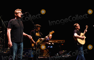 Charlie Reid Photo - 21 September 2018 - Hamilton Ontario Canada  Charlie Reid Garry John Kane Stevie Christie and Craig Reid of Scottish folkrock duo The Proclaimers perform on stage during their Canadian Tour at the FirstOntario Concert Hall  Photo Credit Brent PerniacAdMedia