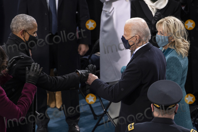 Barack Obama Photo - UNITED STATES - January 20 President-elect Joe Biden greets Former President Barack Obama as he arrives to the West Front of the Capitol for his Inauguration as the 46th President of the United States on Wednesday Jan 20 2021 (Photo by Caroline BrehmanCQ Roll Call)