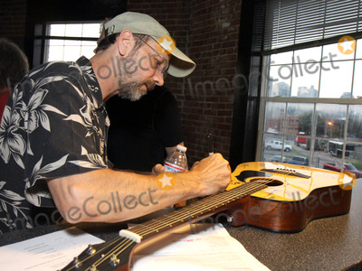 Jeff Taylor Photo - July 26 2011 - Nashville TN - Jeff Taylor autographs a guitar later auctioned off Artists musicians and songwriters came together at Mercy Lounge to help raise funds for Pete Huttlinger a widely respected guitarist and Nashville studio artist  Huttlinger has a congenital heart disease and is in need of a heart transplant Photo credit Dan HarrAdmedia