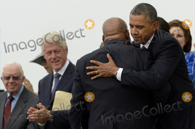 Barack Obama Photo - US President Barack Obama (R) hugs civil rights leader and Democratic Representative from Georgia John Lewis (2-R)after Lewis delivered remarks as former US President Jimmy Carter (L) and former US President Bill Clinton (2-L) look on during the Let Freedom Ring commemoration event at the Lincoln Memorial in Washington DC USA 28 August 2013 The event was held to commemorate the 50th anniversary of the 28 August 1963 March on Washington led by the late Dr Martin Luther King Jr where he famously gave his I Have a Dream speechCredit Michael Reynolds  Pool via CNPAdMedia