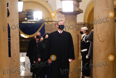 Supremes Photo - Chief Justice John Roberts leads the US Supreme Court Justices as they arrive in the Crypt of the US Capitol for President-elect Joe Bidens inauguration ceremony to be the 46th President of the United States in Washington DC USA 20 January 2021AdMedia