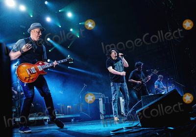 Adam Duritz Photo - 12 May 2015 - Hamilton Ontario Canada  Dan Vickrey (guitarist) Adam Duritz (vocalist) David Immergluck (guitarist) and David Bryson (guitarist) of Counting Crows perform on stage at Hamilton Place Theatre Photo Credit Brent PerniacAdMedia