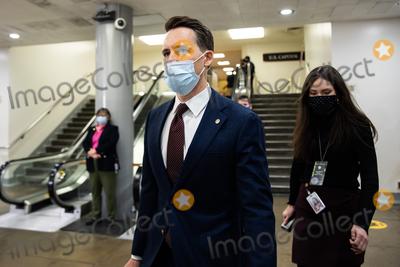 Donald Trump Photo - Senator Josh Hawley R-MO walks on Capitol Hill in Washington Saturday Feb 13 2021 on the fifth day of the second impeachment trial of former President Donald TrumpCredit Graeme Jennings - Pool via CNPAdMedia