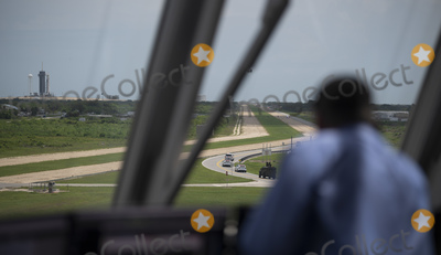 The National Photo - In this photo released by the National Aeronautics and Space Administration (NASA) Tthe convoy carrying NASA astronauts Robert Behnken and Douglas Hurley is seen through the windows of firing room four as it makes its way to Launch Complex 39A ahead of the launch of NASAs SpaceX Demo-2 mission Saturday May 30 2020 in the Launch Control Center at NASAs Kennedy Space Center in Florida NASAs SpaceX Demo-2 mission is the first launch with astronauts of the SpaceX Crew Dragon spacecraft and Falcon 9 rocket to the International Space Station as part of the agencys Commercial Crew Program The test flight serves as an end-to-end demonstration of SpaceXs crew transportation system Behnken and Hurley are scheduled to launch at 322 pm EDT on Saturday May 30 from Launch Complex 39A at the Kennedy Space Center A new era of human spaceflight is set to begin as American astronauts once again launch on an American rocket from American soil to low-Earth orbit for the first time since the conclusion of the Space Shuttle Program in 2011 Mandatory Credit Joel Kowsky  NASA via CNPAdMedia
