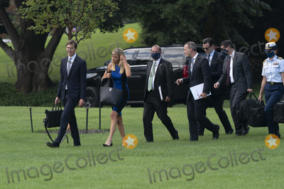 Alex Azar Photo - From left Jared Kushner Assistant to the President and Senior Advisor White House Press Secretary Kayleigh McEnany United States Secretary of Health and Human Services (HHS) Alex Azar and US International Development Finance Corporation CEO Adam Boehler  and other White House staff walk across the South Lawn of the White House in Washington DC as they prepare to accompany US President Donald J Trump on a visit to the Bioproces Innovation Center at Fujifilm Diosynth Biotechnologies in Morrisville North Carolina on July 27 2020Credit Chris Kleponis  Pool via CNPAdMedia