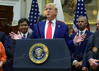 The Used Photo - United States President Donald J Trump holds a chart on the border wall as he takes questions from the press after the US-Japan Trade Agreement and US-Japan Digital Trade Agreement was signed in the Roosevelt Room of the White House in Washington DC on Monday October 7 2019 Photo Credit Ron SachsCNPAdMedia