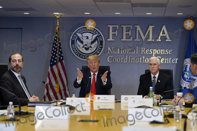Alex Azar Photo - United States President Donald J Trump speaks during a teleconference with governors at the Federal Emergency Management Agency headquarters Thursday March 19 2020 in Washington DC From left US Secretary of Health and Human Services (HHS) Alex Azar Trump and US Vice President Mike Pence Credit Evan Vucci  Pool via CNPAdMedia