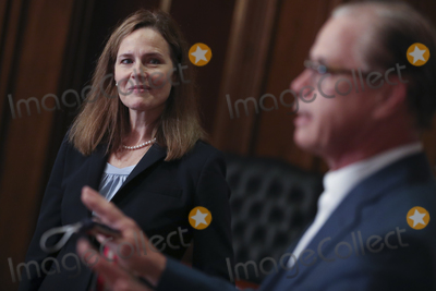 Seal Photo - Amy Coney Barrett US President Donald Trumps nominee for associate justice of the US Supreme Court left meets with Senator Mike Braun a Republican from Indiana at the US Capitol in Washington DC US on Wednesday Sept 30 2020 A bruising Senate confirmation fight over Trumps Supreme Court choice may seal the fates of several incumbent senators in the November election though it has yet to drastically alter the odds for which party will control the chamber Photographer Oliver ContrerasBloomberg(Photo by Oliver ContrerasBloomberg)Credit Oliver Contreras  Pool via CNPAdMedia