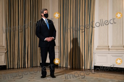 The Specials Photo - John Kerry the Special Presidential Envoy for Climate waits for the start of an event on President Joe Bidens administrations response to climate change in the State Dining Room of the White House in Washington DC January 27th 2021 Credit Anna Moneymaker  Pool via CNPAdMedia
