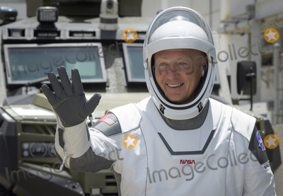 The National Photo - In this photo released by the National Aeronautics and Space Administration (NASA) NASA astronaut Douglas Hurley waves as he and fellow crew member Robert Behnken depart the Neil A Armstrong Operations and Checkout Building for Launch Complex 39A to board the SpaceX Crew Dragon spacecraft for the Demo-2 mission launch Saturday May 30 2020 at NASAs Kennedy Space Center in Florida NASAs SpaceX Demo-2 mission is the first launch with astronauts of the SpaceX Crew Dragon spacecraft and Falcon 9 rocket to the International Space Station as part of the agencys Commercial Crew Program The test flight serves as an end-to-end demonstration of SpaceXs crew transportation system Behnken and Hurley are scheduled to launch at 322 pm EDT on Saturday May 30 from Launch Complex 39A at the Kennedy Space Center A new era of human spaceflight is set to begin as American astronauts once again launch on an American rocket from American soil to low-Earth orbit for the first time since the conclusion of the Space Shuttle Program in 2011 Mandatory Credit Bill Ingalls  NASA via CNPAdMedia