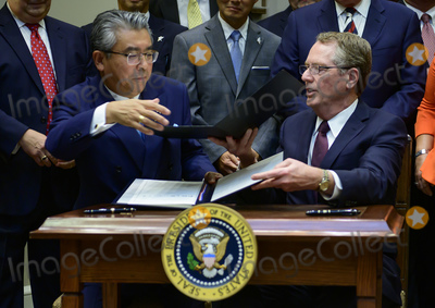 The Used Photo - Ambassador Shinsuke Sugiyama Ambassador of Japan to the United States left and US Trade Representative Robert Lighthizer right exchange documents as they sign the US-Japan Trade Agreement and US-Japan Digital Trade Agreement in the Roosevelt Room of the White House in Washington DC on Monday October 7 2019 Photo Credit Ron SachsCNPAdMedia