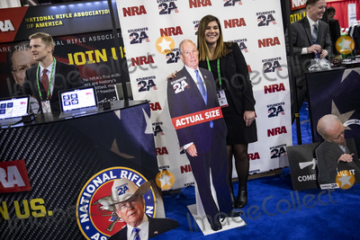 Michael Bloomberg Photo - OXON HILL Md - FEBRUARY 27 Erin Demma stands with a cut out of Democratic Presidential hopeful former New York City Mayor Michael Bloomberg at the Conservative Political Action Conference CPAC 2020 in Oxon Hill Md on Thursday February 27 2020Credit Samuel Corum  CNPAdMedia