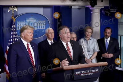 Alex Azar Photo - United States Secretary of State Mike Pompeo canter speaks as US President Donald J Trump left listens during a Coronavirus Task Force news conference in the briefing room of the White House in Washington DC US on Friday March 20 2020 Americans will have to practice social distancing for at least several more weeks to mitigate US cases of Covid-19 Anthony S Fauci of the National Institutes of Health said today Looking on from behind from left to right US Vice President Mike Pence Director of the National Institute of Allergy and Infectious Diseases at the National Institutes of Health Dr Anthony Fauci (partially obscured) Dr Deborah L Birx White House Coronavirus Response Coordinator and US Secretary of Health and Human Services (HHS) Alex AzarCredit Al Drago  Pool via CNPAdMedia