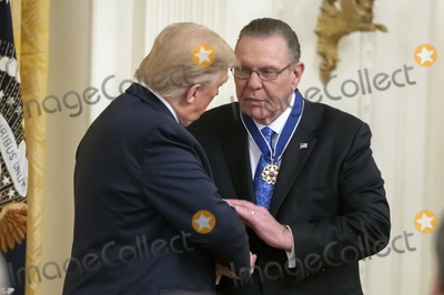 Keane Photo - United States President Donald J Trump left shakes hands with US Army General John M Jack Keane (retired) right after presenting him with the Presidential Medal of Freedom during a ceremony in the East Room of the White House in Washington DC on Tuesday March 10 2020  Keane is a former Vice Chief of Staff of the US Army and is a Fox News national security analystCredit Ron Sachs  CNPAdMedia