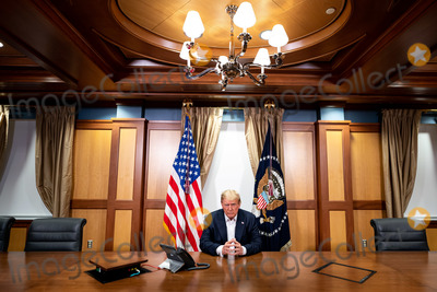 Mike Pompeo Photo - In this photo released by the White House United States President Donald J Trump participates in a phone call with US Vice President Mike Pence US Secretary of State Mike Pompeo and Chairman of the Joint Chiefs of Staff Gen Mark Milley Sunday October 4 2020 in his conference room at Walter Reed National Military Medical Center in Bethesda Maryland Not shown in the photo also in the room on the call is Chief of Staff Mark Meadows Mandatory Credit Tia Dufour  White House via CNPAdMedia