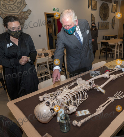 Prince Photo - 18th December 2020 - Prince Charles Prince of Wales looking at the skeleton of Bodicacia with Schools and Families Officer Rebecca Shellenberger during a visit to the Corinium Museum in Cirencester and viewed their interactive galleries depicting the story of the life in the Cotswolds from 40000 years ago right up to the early- Corinium era (early Roman times) including Bronze Age and Iron Age artefacts HRH toured the new Stone Age to Corinium Gallery and saw some of their key exhibits and some newly acquired pieces Photo Credit ALPRAdMedia