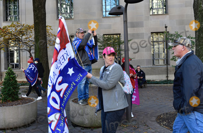 Supremes Photo - A man stands on a planter to photograph fellow participants in the pro-Trump MAGA rally march up Pennsylvania Avenue Northwest from Freedom Plaza to the United States Supreme Court around in Washington DC on Saturday November 14 2020Credit Rod Lamkey  CNPAdMedia