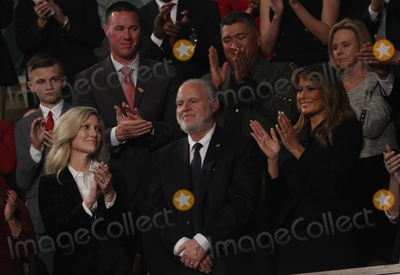 Rush Photo - FILE PHOTO Radio personality Rush Limbaugh is honored by US President Donald Trump with a Presidential Medal of Freedom as he stands with first lady Melania Trump during the State of the Union address to a joint session of the US Congress in the House Chamber of the US Capitol in Washington US February 4 2020 Credit Leah Millis  Pool via CNPAdMedia