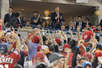 TI Photo - United States President Donald J Trump participates in a moment to salute the military during game five of the World Series at Nationals Park in Washington DC on October 27 2019 The Washington Nationals and Houston Astros are tied at two games going into tonights game Credit Chris Kleponis  Pool via CNPAdMedia