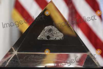 The National Photo - A moon rock encased in acrylic sits on a table ahead of Bill Nelson former Democratic Senator from Florida and administrator of the National Aeronautics and Space Administration (NASA) during a swearing in ceremony with US Vice President Kamala Harris in the Eisenhower Executive Office Building in Washington DC US on May 3 2021 The Senate confirmed Nelson on April 29 and had served as the chairman and ranking member of the Senate subcommittee that oversees NASA Credit Oliver Contreras  Pool via CNPAdMedia