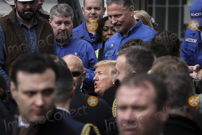 The Stage Photo - United States President Donald J Trump talks to people on the stage after signing the United States-Mexico-Canada Trade Agreement on the South Lawn of the White House on January 29 2020 in Washington DC Credit Oliver Contreras  Pool via CNPAdMedia