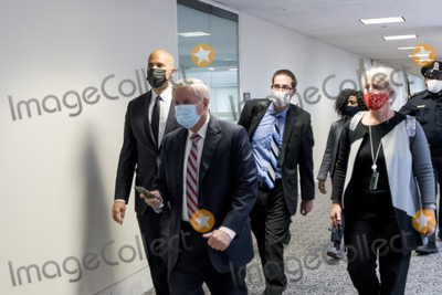 Cory Booker Photo - United States Senator Cory Booker (Democrat of New Jersey) left and United States Senator Lindsey Graham (Republican of South Carolina) second from left and other Senators evacuate to a safe place in the Dirksen Senate Office Building after Electoral votes being counted during a joint session of the United States Congress to certify the results of the 2020 presidential election in the US House of Representatives Chamber in the US Capitol in Washington DC on Wednesday January 6 2021 as interrupted as thousands of pr-Trump protestors stormed the US Capitol and the House chambers  Credit Rod Lamkey  CNPAdMedia