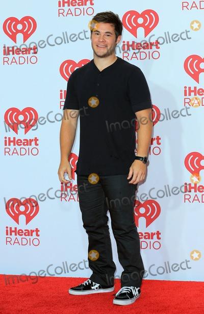 Adam DeVine Photo - 19 September 2014 - Las Vegas Nevada - Adam DeVine 2014 iHeart Radio Music Festival day 1 red carpet at MGM Grand Garden Arena  Photo Credit MJTAdMedia