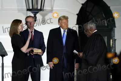 Supremes Photo - Associate Justice of the Supreme Court Clarence Thomas administers the oath of office to Judge Amy Coney Barrett to be Associate Justice of the Supreme Court on the South Lawn of the White House in Washington DC on Monday October 26 2020  US President Donald J Trump and her husband Jesse M Barrett look onCredit Chris Kleponis  Pool via CNPAdMedia
