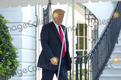 White House Photo - United States President Donald J Trump walks out of the White House in Washington DC US as he departs for Yuma Arizona on Tuesday June 23 2020  Trump stated that he authorized the Federal government to arrest any demonstrator caught vandalizing US monuments with a punishment of up to 10 years in prison  Credit Stefani Reynolds  CNPAdMedia