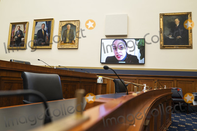 Alexandria Ocasio-Cortez Photo - United States Representative Alexandria Ocasio-Cortez (Democrat of New York) appears in a monitor as she questions Federal Reserve Chair Jerome Powell and Treasury Secretary Steven Mnuchin during a House Financial Services Committee hearing on Oversight of the Treasury Departments and Federal Reserves Pandemic Response in the Rayburn House Office Building in Washington DC USA 02 December 2020Credit Jim LoScalzo  Pool via CNPAdMedia