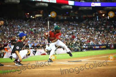 Ricky Henderson Photo - 10 July 2011 - Phoenix Arizona - Rickie Henderson hits a home run 2011 Taco Bell All-Star Legends  Celebrity Softball Game Batting Practice held at  Chase Field Photo Credit Darrylee CohenAdMedia