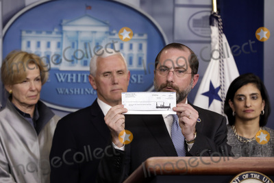 Alex Azar Photo - US Health and Human Services (HHS) Secretary Alex Azar holds 100000 Q4 salary check donated to HHS by President Donald Trump to fight coronavirus during a press conference with Vice President Mike Pence and members of the Coronavirus Task Force at the White House in Washington on March 3 2020 Looking on  from left to right White House coronavirus response coordinator Dr Deborah Bir Vice President Pence and Seema Verma Administrator Centers for Medicare and Medicaid ServicesCredit Yuri Gripas  Pool via CNPAdMedia
