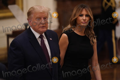 The Ceremonies Photo - United States President Donald Trump and First lady Melania Trump depart the ceremony where the President presented the Medal of Honor to Sergeant Major Thomas Payne United States Army left in the East Room of the White House in Washington DC on September 11 2020 Payne is the 1st living Delta Force member to receive the Medal of Honor Credit Chris Kleponis  Pool via CNPAdMedia